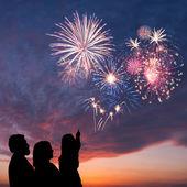 Happy family and holiday fireworks — Stock Photo