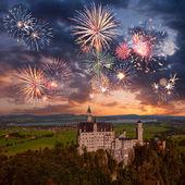 Neuschwanstein castle and fireworks — Stock Photo