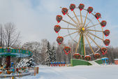 Carousel in winter park — Stock Photo