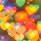 Bokeh background with hearts and stars — Stock Photo