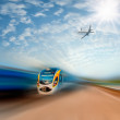 Commuter train and airplane — Foto Stock