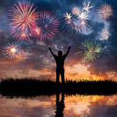 A man looks holiday fireworks — Stock Photo