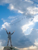 A man and flight of flying birds — Stock Photo