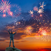 A man on beautiful holiday fireworks background — Photo