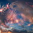Fireworks in evening sky with clouds — Stock Photo #25824663