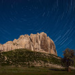 Mountaine and startrails in sky — Stock Photo