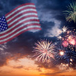 Stock Photo: Holiday fireworks with national flag of USA