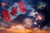 Holiday fireworks with national flag of Canada — Stock Photo