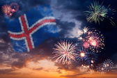 Holiday fireworks with national flag of Iceland — Stock Photo