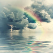 Vintage rainbow over ocean — Stock Photo