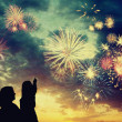 Family looks holiday fireworks — Stock Photo