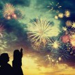 Family looks holiday fireworks — Stockfoto