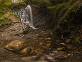 Waterfall in the mountains — Стоковое фото