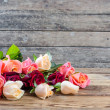 Stock Photo: Roses on old wooden table