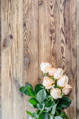 Roses on rustic table — Stock Photo