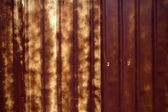 Iron fence Rusty old corrugated iron — Stock Photo