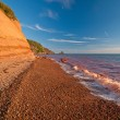 Stock Photo: Red Waves on Red Sandstone Beach