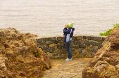 Birdwatcher on a coastal viewpoint — Stock Photo