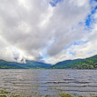 Stock Photo: Summer Clouds over Mountain Lake