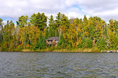 House on a remote lake in the fall — Stock Photo