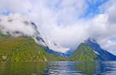 Ocean Fjord in clouds and sun — Stock Photo