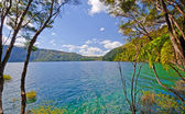 Blue lake and skies on a summer day — Stock Photo