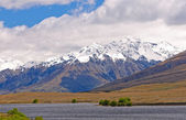 Snow Capped Mountains above a Remote Lake — Stock Photo