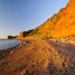 Gravel Beach in Red of Sunset — Stock Photo #23546441