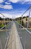 Suspension Bridge for a foot trail — Stock Photo