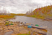 Autumn Portage ont a remote lake — Stock Photo