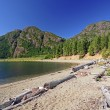 Wilderness beach on a mountain Lake — Stock Photo