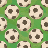 Soccer balls on grass, seamless — Stock Vector