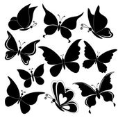 Butterflies, black silhouettes — Stock Vector
