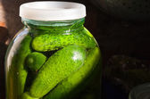 Glass jar with fresh salted cucumbers — Stock Photo