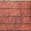 Old red slate tiles roof background texture — Stock Photo #12482910