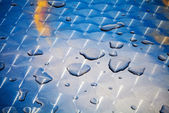 Texture of water drops on shining metal table surface — Stock Photo