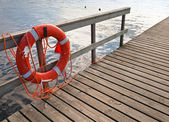 Lifebuoy on the wooden pier — Stock Photo