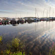 Yachts and pleasure boats moored in small European marina — ストック写真