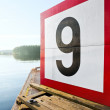 "Stock Photo: Water navigation depth mark ""9"""