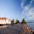 Small white pleasure boat moored on Saimaa lake — Stock Photo
