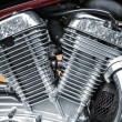 Shiny motorcycle engine fragment — Stock Photo #13514901