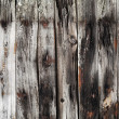 Old dark gray weathered wooden lining boards surface — Stock Photo #13581084
