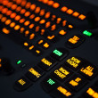 Fragment of illuminated industrial keyboard in the dark — Stock Photo