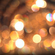 Defocused abstract golden lights background. — Стоковая фотография