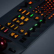 Fragment of colorful illuminated industrial control panel - Stock Photo