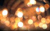 Defokussiert abstrakte goldene lichter hintergrund. — Stockfoto