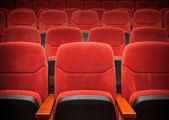 Red velvet armchairs in the empty auditorium — Stock Photo