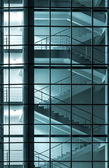 Modern building facade with staircase behind glass wall — Stock Photo