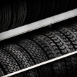 Row of car tires on the counter - Stock Photo