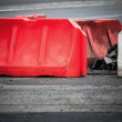 Red and white barrier blocks on the road — Stock Photo